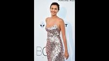 Irina Shayk, con vestido de 'paillettes' con bajo degradado, de Prada.